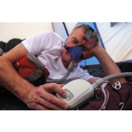 Man in Bed with Transcend EZEX Travel CPAP Machine