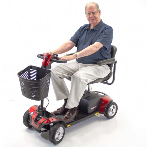 Man sitting in a Red 4 Wheel Travel Mobility Scooter