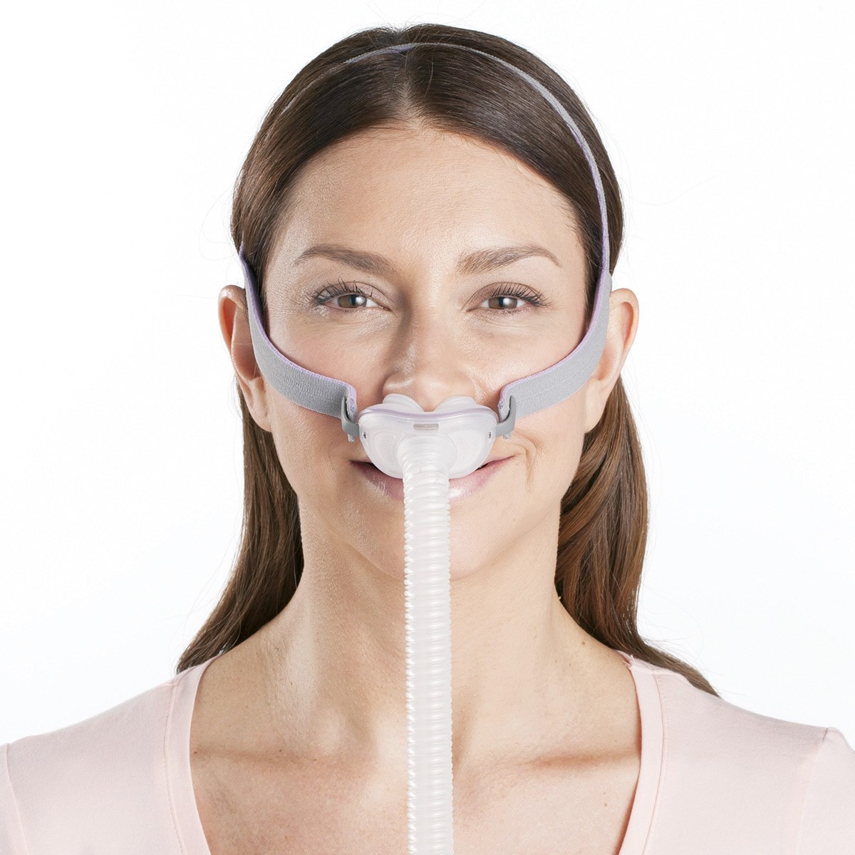 Woman wearing a AirFit P10 Nasal Pillow CPAP Mask with Headgear