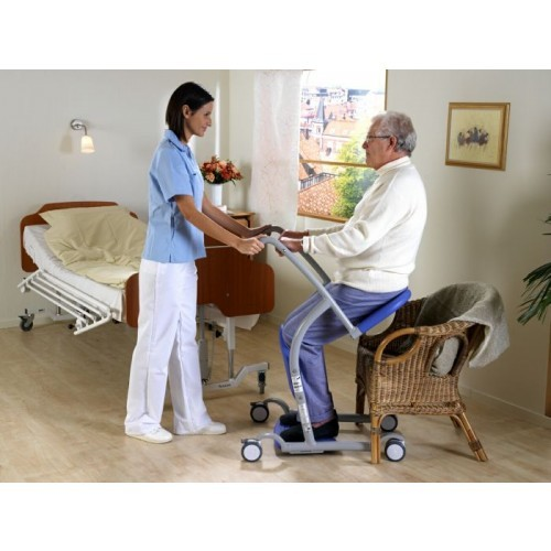 Man sitting in Arjohuntleigh Sara Steady Standing Transfer Aid over Chair