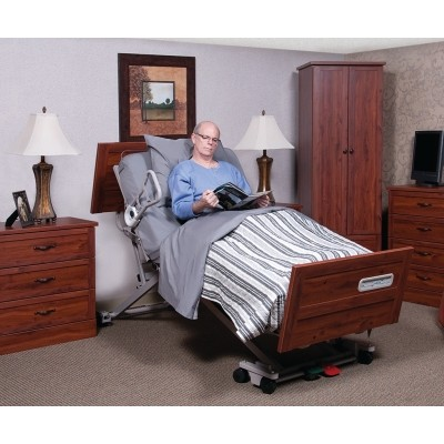 Man sitting in Basic American Zenith 9100 Hi Low Hospital Bed