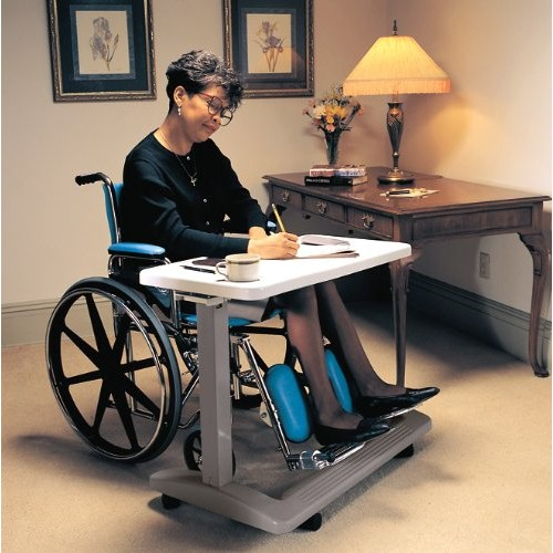Woman doing paperwork on Carex Home Overbed Table