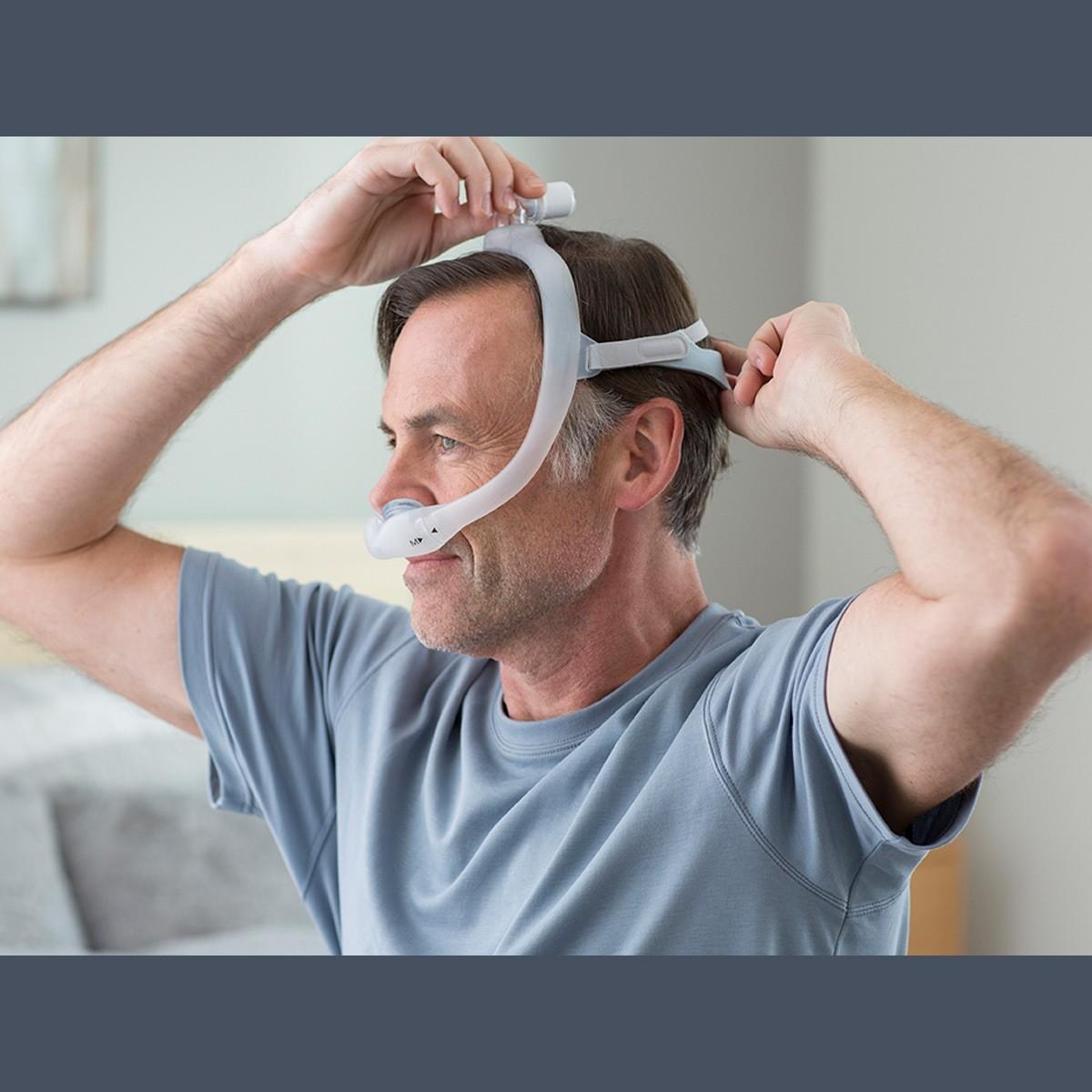 Man wearing a DreamWear Gel Nasal Pillow CPAP Mask with Headgear