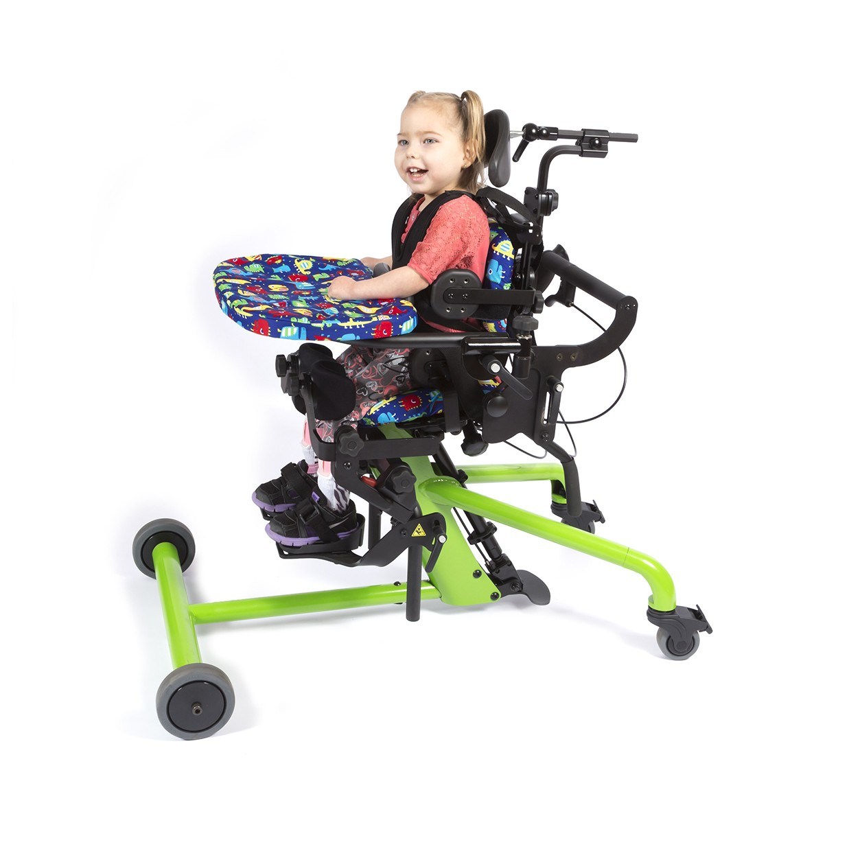 Child sitting in a Green EasyStand Bantam Extra Small