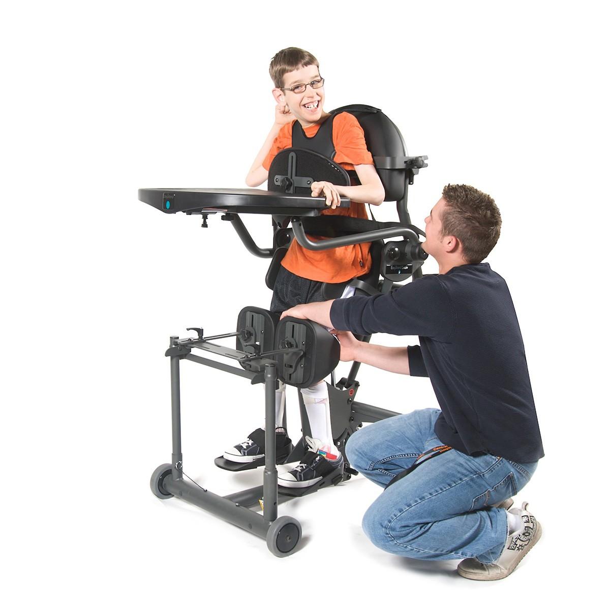 Boy standing on a EasyStand Evolv E3 Medium