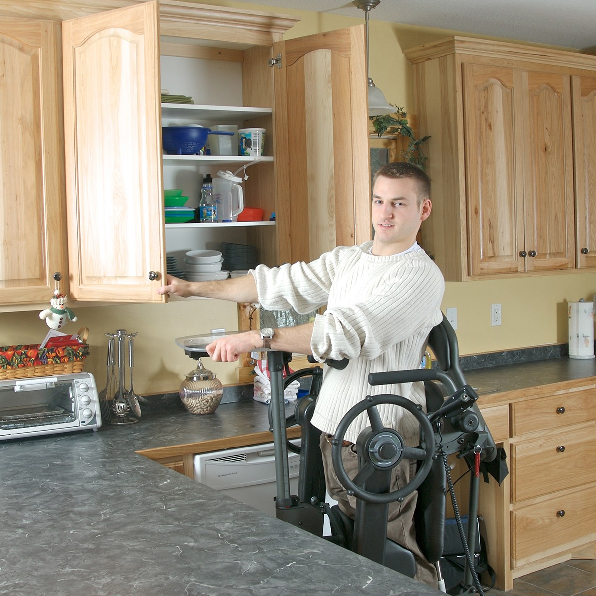 Man standing in a EasyStand Evolv Large in the Kitchen