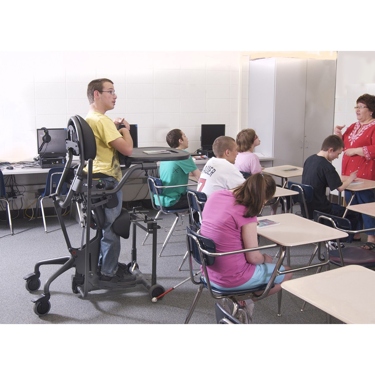 Boy standing on a EasyStand Evolv Medium in a classroom