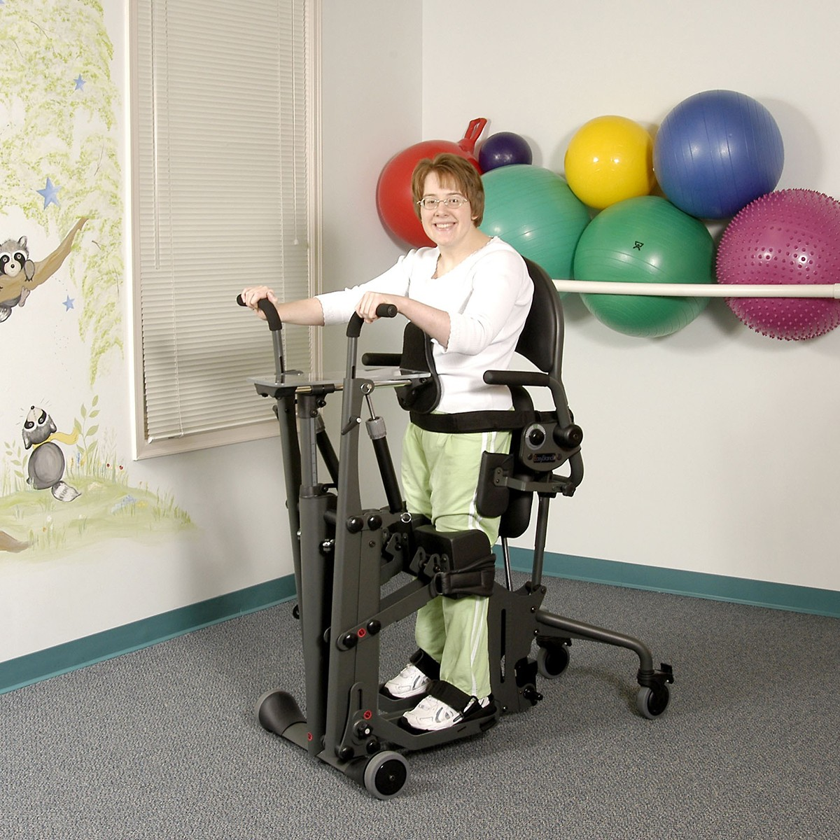 Woman standing on a EasyStand Glider Medium