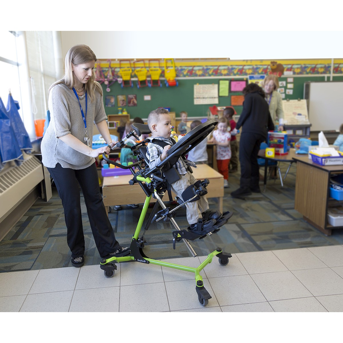 Child standing in a Green EasyStand Zing MPS Size 1