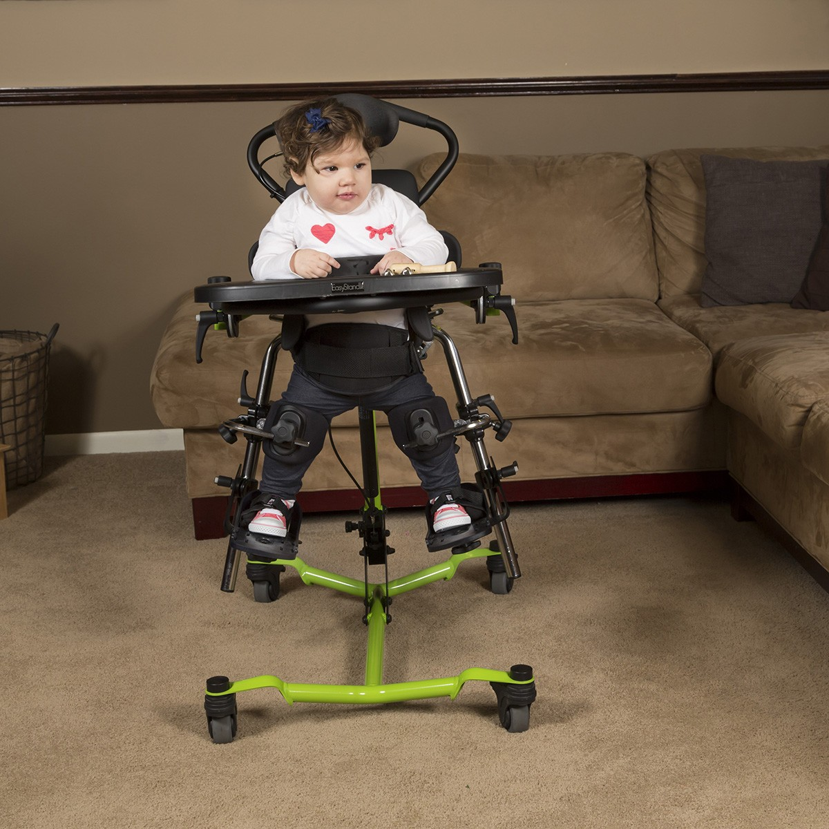Child sitting in a EasyStand Zing MPS Size 1