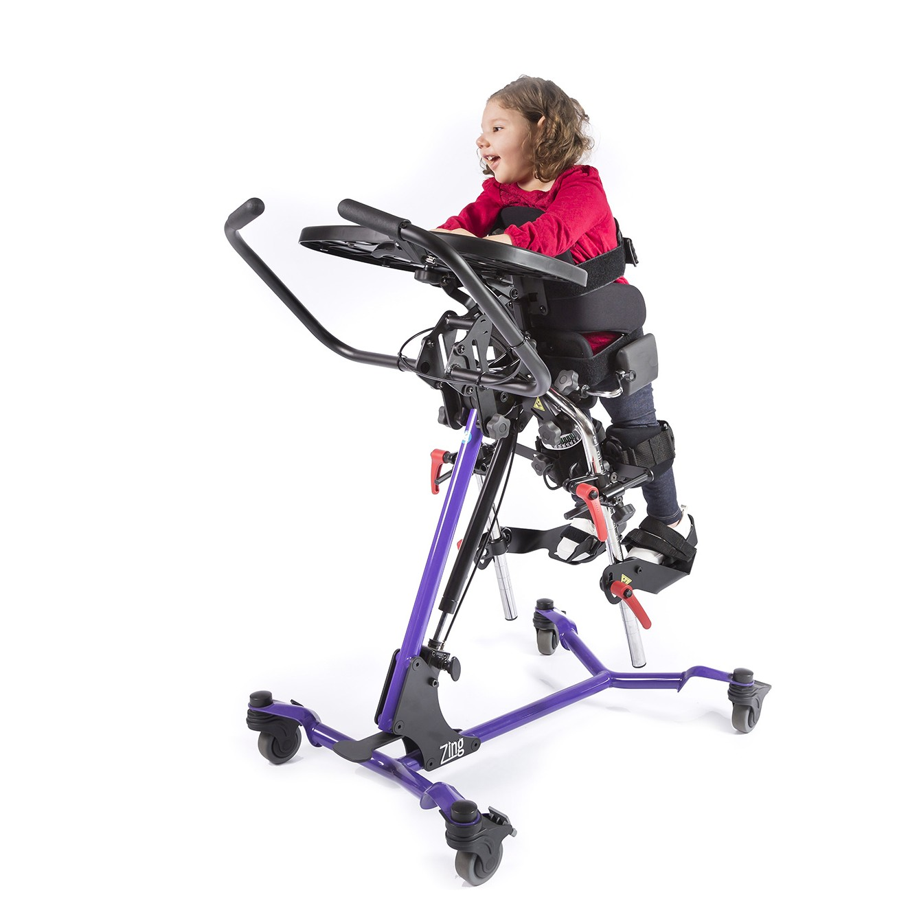 Child standing on a Purple EasyStand Zing Prone Size 1
