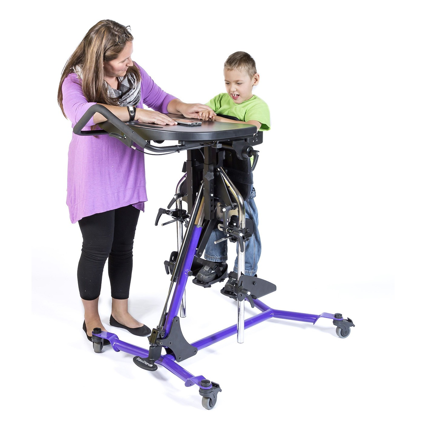 Boy standing on a Purple EasyStand Zing Prone Size 2 Gas Spring Lift
