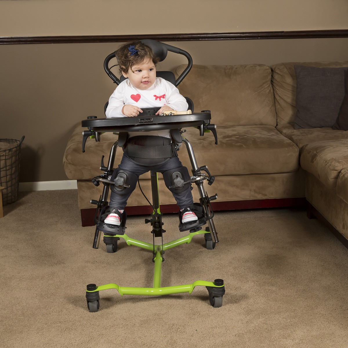 Child standing in a Green EasyStand Zing Supine Size 1