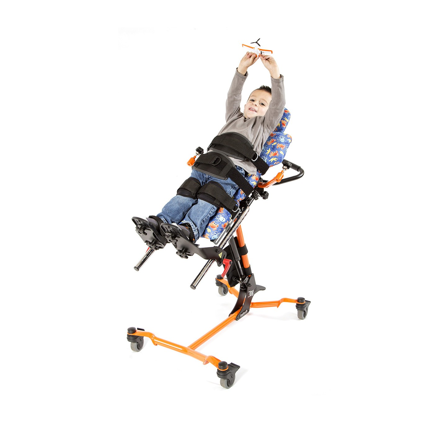 Child laying in Orange EasyStand Zing Supine TT Size 1