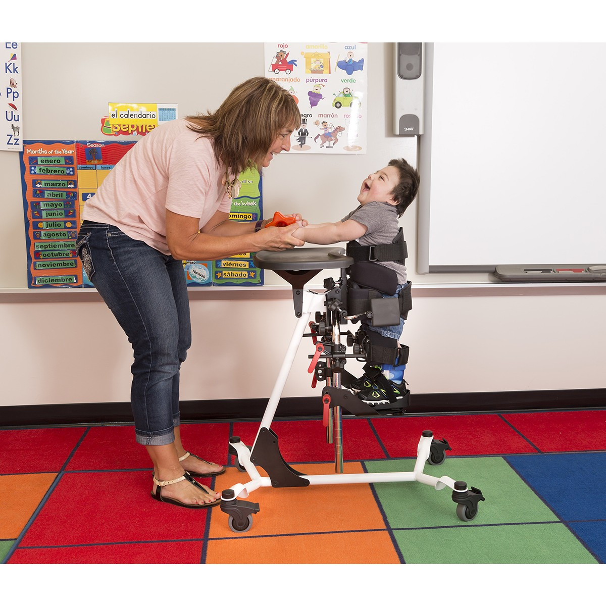 Child standing in a EasyStand Zing Vertical Size 1 in a classroom