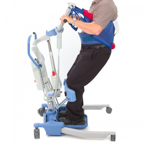 Man sitting in Blue an Electric/Power Standing Patient Lift