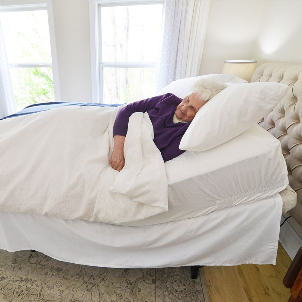 Woman sleeping in a Flex-a-Bed 185 Hi-Low Adjustable Bed