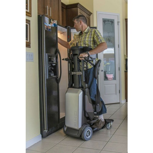 Man standing in a Matia Robotics TEK RMD while getting items out of a fridge