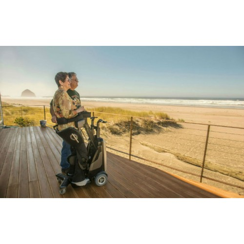 Woman standing on a Matia Robotics TEK RMD with Man next to her overlooking Ocean