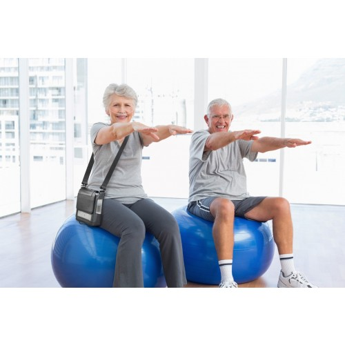 Man and Woman with Inogen One G5 Portable Oxygen Concentrator on Medicine Ball
