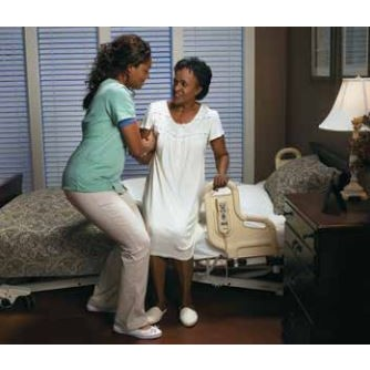 Woman getting into a Joerns Ultracare XT Long Term Care Bed
