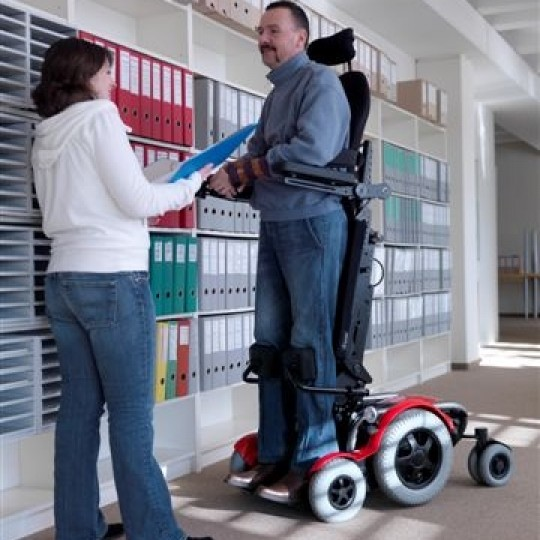 Man standing in a LEVO C3 Standing Power Wheelchair