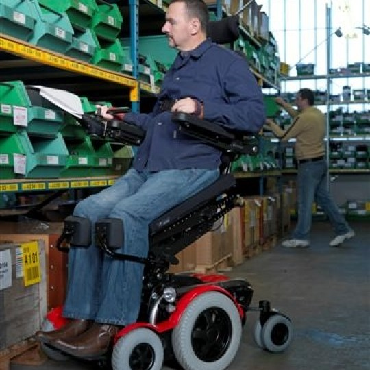 Man sitting in LEVO C3 Standing Power Wheelchair at Store