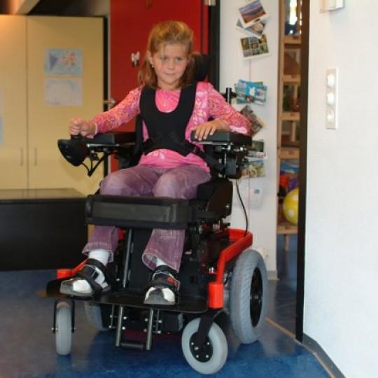 Child sitting in LEVO Combi Jr Standing Power Chair