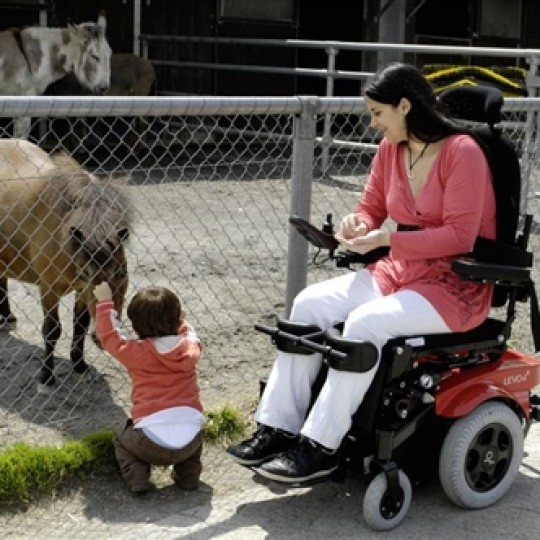 Woman sitting in a Levo Combi Standing Power Wheelchair