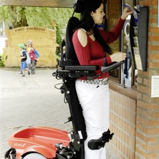 Woman standing in a Levo Combi Standing Power Wheelchair