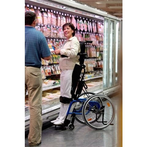 Woman sitting in LEVO LCEV Standing Manual Wheelchair while grocery shopping
