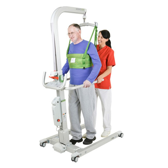 Man in a sling standing on a Liko Golvo 9000 Electric Patient Lift