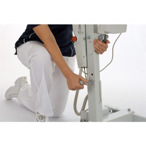 Woman using handle to Adjust the Liko Sabina 200 Electric Sit-To-Stand Lift