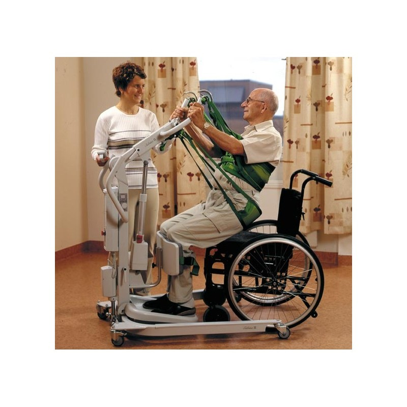 Man using sling on a Liko Sabina II Electric Sit-To-Stand Lift to Sit in Wheelchair