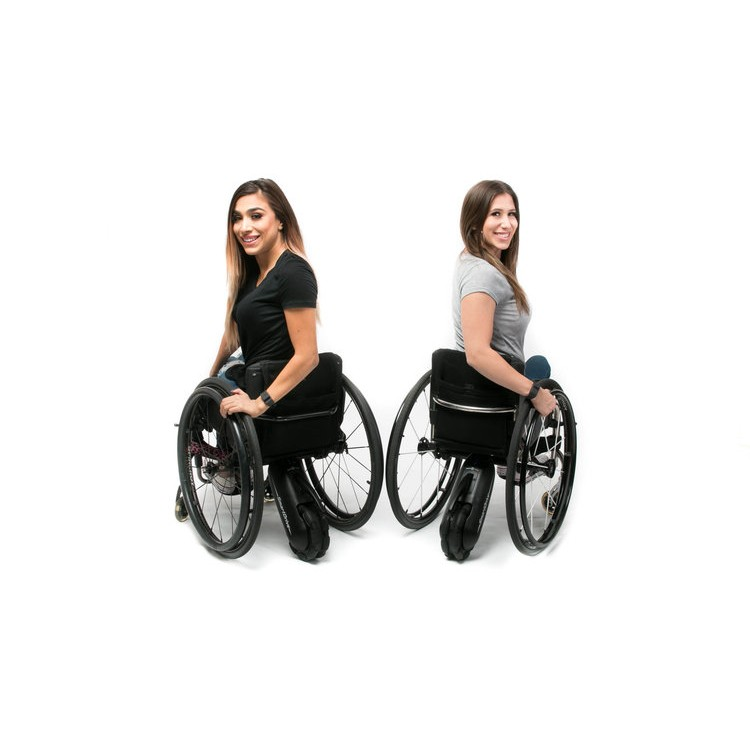 Two woman sitting in two Max Mobility Smart Drive MX2+