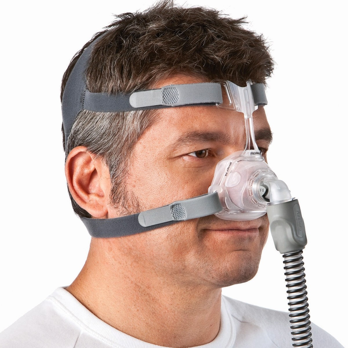 Man wearing a Mirage FX Nasal CPAP Mask with Headgear