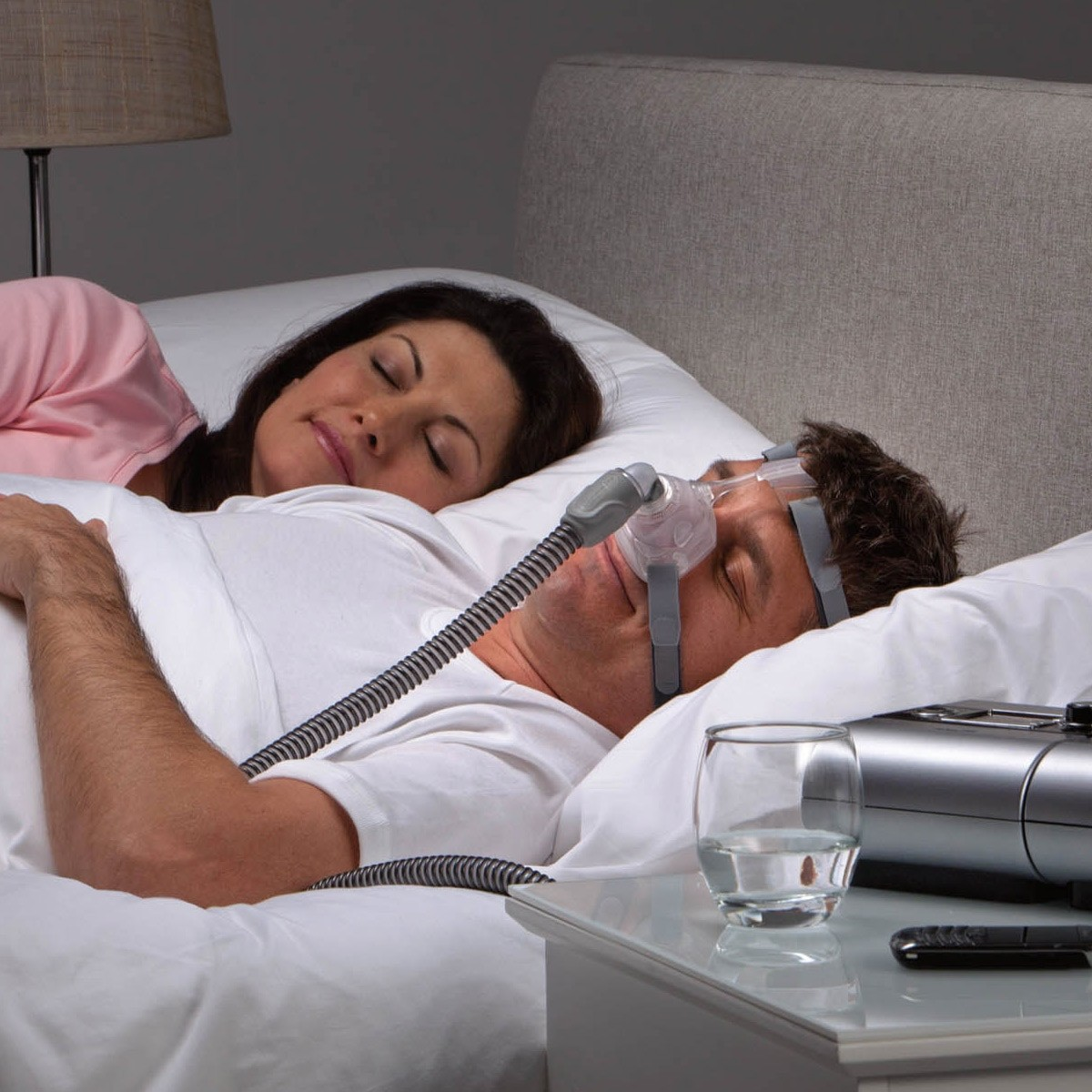 Man sleeping with a Mirage FX Nasal CPAP Mask with Headgear