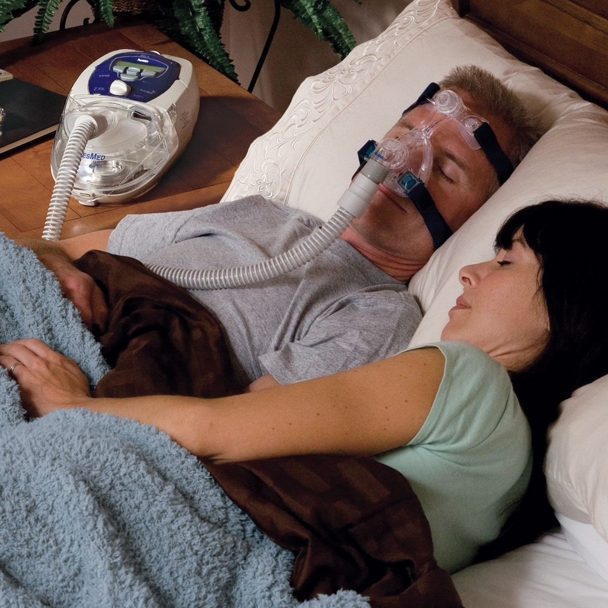 Man sleeping with a Mirage Micro Nasal CPAP Mask with Headgear