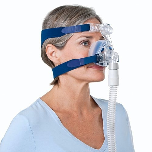 Woman wearing a Mirage SoftGel Nasal CPAP Mask with Headgear