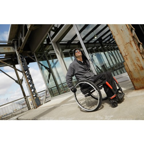 Man sitting in Motion Composites Apex Wheelchair
