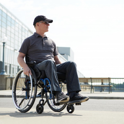 Man sitting on Motion Composites Helio A7 Wheelchair