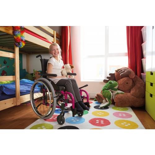 Girl sitting on Pink Helio Kids Wheelchair
