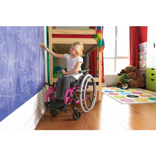 Girl playing while on Pink Helio Kids Wheelchair