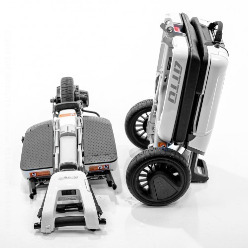 Two folded Moving Lift Atto Folding Mobility Scooters