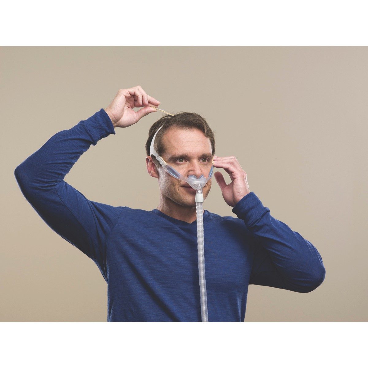Man wearing a Nuance & Nuance Pro Nasal Pillow CPAP Mask with Gel Nasal Pillows