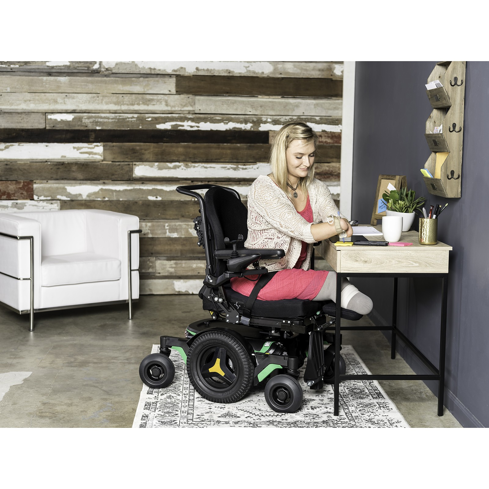 Woman sitting in Permobil M1 Mid Wheel Power Wheelchair
