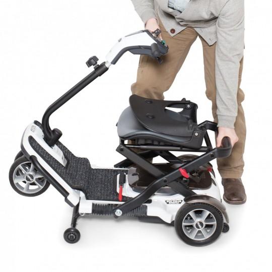 Folding a White Pride Mobility Go-Go Folding Mobility Scooter