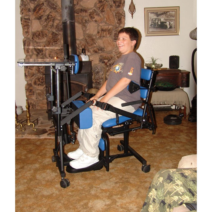 Boy sitting in a Prime Engineering Symmetry Stander