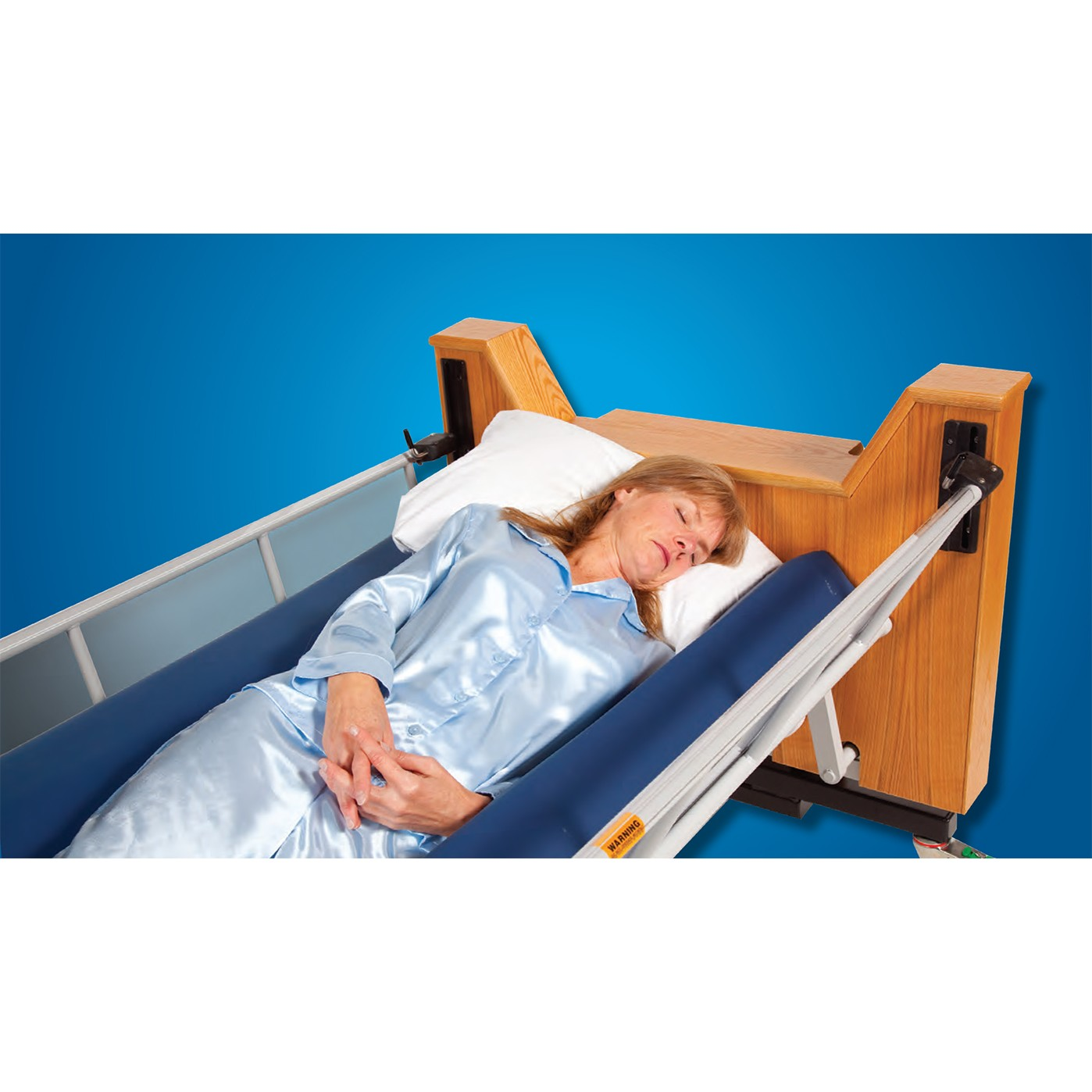 Woman sleeping in a ProBed Medical The Freedom Bed