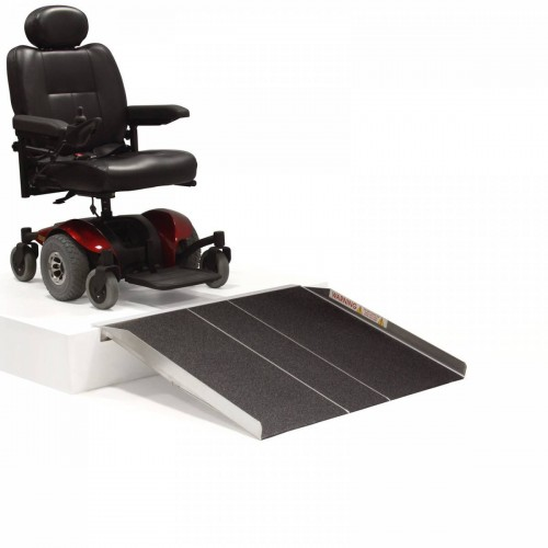 Wheelchair positioned on Stand with PVI Solid Ramp Extended to Floor